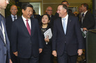 President Xi Jinping of China walks with Prime Minister John Key. Photo / Getty Images