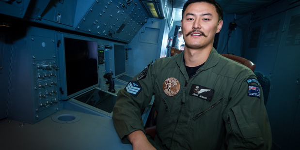RNZAF Air Warfare Specialist Sergeant Jack Xiong onboard a P-3K2 Orion aircraft.