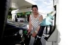 PUMP: Tauranga redisdent Sharyn Tumataroa, 46, doesn't shop around for petrol prices. PHOTO/RUTH KEBER