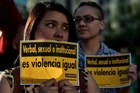 Activists hold signs at a reproductive rights demonstration in Santiago, Chile, this month. Photo / AFP