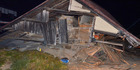 A house collapsed after a strong earthquake hit in Hakuba, Nagano Prefecture, central Japan. Photo / AP