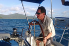 Ewan McDonald takes the helm while sailing in the Whitsundays Islands in Queensland. Photo / Ewan McDonald