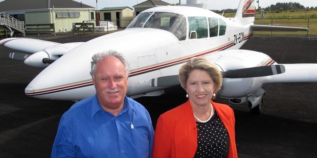FLIGHT PATH WARS: Sunair Aviation owners Dan and Bev Power with one of their Piper Aztecs on a flying visit to Kaitaia Airport on Friday.