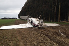 The plane went through a farm fence at the end of the runway and flipped upside down. Photo / Supplied