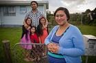 Sio Talakai-Alatini with her husband Loloa Alatini and their three girls Simaima, 9, Heilala, 5, and Losaline, 7, at the family home. Photo / Greg Bowker