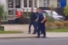 AC/DC drummer Phil Rudd taken by police outside Tauranga Girls' College this morning.