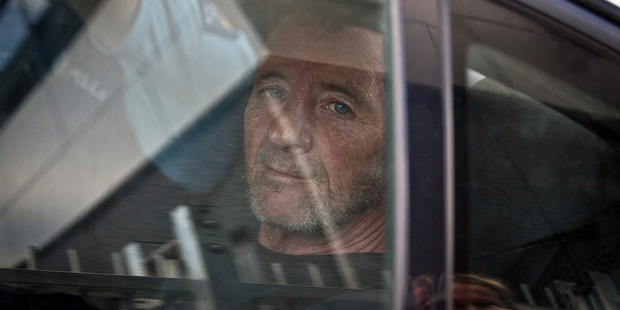 Loading Phil Rudd arrives at the Tauranga Police Station after being detained by police near Tauranga Girls' College. Photo / Andrew Warner
