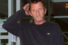 AC/DC drummer Phil Rudd outside the District Court at Tauranga today. Photo / Alan Gibson