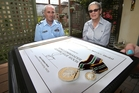 Marilyn Guilford accepted a Defence Meritorious Service Medal on behalf of her daughter Leanne Woon.Photo / John Borren