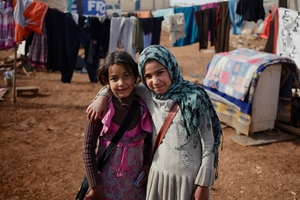 Refugees Raghad al Hasan, 9, left, and Reham Abd al Sattar, 9, have fled the war in Syria to Amman, Jordan. Photo / AP