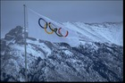 The Olympic flag flies during the 1988 Winter Olympics in Calgary. Photo / Getty Images