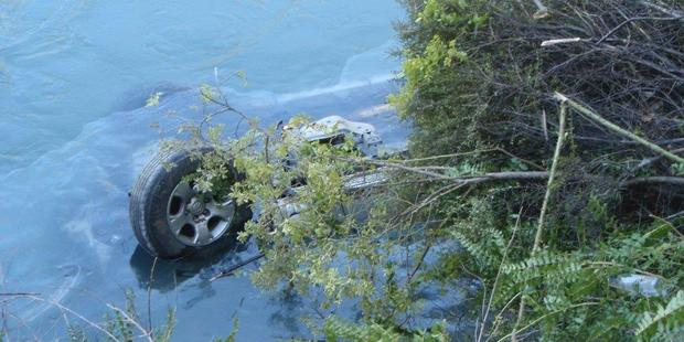 A drive escaped drowning after their car landed upside-down in a river. Photo / APNZ