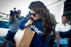 Lorde escapes from New Zealand media after landing at Auckland Airport. Photo/Sarah Ivey