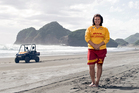 Bethells Beach lifeguard Lyn Maxlow is one of 17,000 Surf Life Saving members who work to keep Kiwis safe at the nation's beaches. Photo / Chris Sisarich