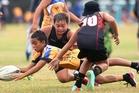 Tai Solomon (with ball), Bay of Plenty boys under-11 player, up against Waikato at Puarenga Park on Sunday. Photo/Ben Fraser