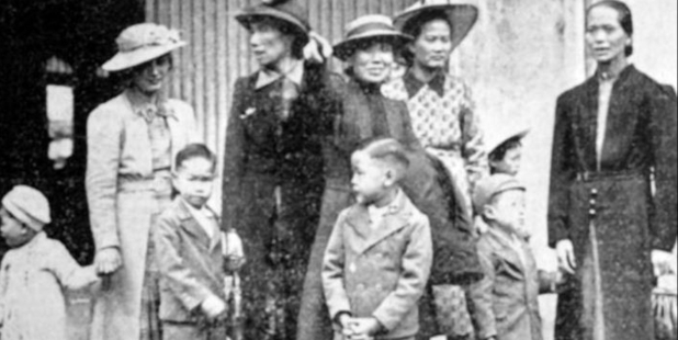 Ken Chan, above, with hands clasped, and far right, arrived  in 1939. Behind him, his aunt points at his father,  whom  Ken is about to meet for the first time.