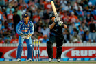 Ross Taylor hits a four during the fourth ODI against India. Photo / Getty Images
