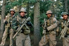 From left, Taylor Kitsch, Mark Wahlberg, Ben Foster and Emile Hirsch in a scene from Lone Survivor.