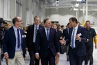 Mark Kennedy, left, SCA general manager operations New Zealand, and Peter Diplaris, right, president, speak with Prime Minister John Key at yesterday's opening. Photo / APN