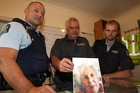 FOUND: (From left) Senior Constable Tony Matheson, Senior Constable Pete Cunningham and Constable Hayden Robinson at search and rescue headquarters at Hood Aerodrome with a photo of Mrs Roberts.PHOTO/FILE