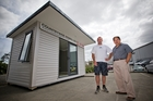Graeme Reynolds and Dewey Yu of Countrywide Homes show off one of the prefabs. Photo / Greg Bowker