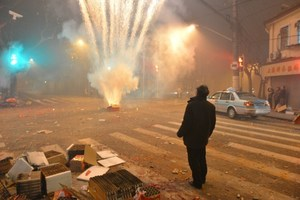 Fireworks explode in a street of Shanghai on the eve of Chinese New Year. Photo / AFP