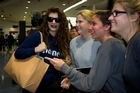 "Singer-songwriter Lorde was swamped by fans and media when she arrived home to Auckland this morning after a whirlwind week in Los Angeles which saw her become a global superstar. The 17-year-old took the time to meet adoring fans, sign autographs, pose for photographs and talk to the media, despite being ""very tired"" after a long flight."