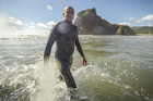 Long-time Piha resident Steve Davis rues the loss of famous surf breaks as sand continues to pile up off the west coast beach. Photo / Michael Craig