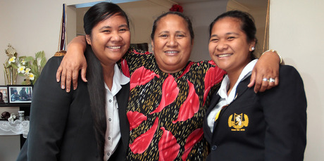 Proud mum Aipoi Pauli with Pemita (L), who's taking over the role of head girl from her sister Phyllein (R). Photo / Doug Sherring