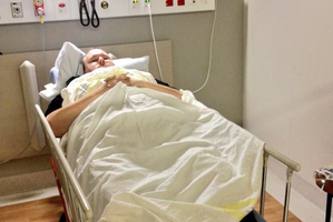 Kim Dotcom tweeted from his hospital bed: 'X-ray showed foot fracture. Can't move, severe back pain.'