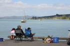 Fishing off Kawhia Wharf. Photo / Philippe Dierick