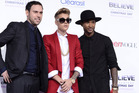 Producer Scooter Braun (left), Justin Bieber and Usher. Photo / AP