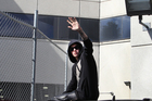Singer Justin Bieber waved from atop an SUV as he left the Turner Guilford Knight Correctional Centre. He's now had nearly all charges against him dropped. Photo / AP