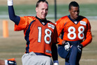 Peyton Manning (18) stretches at practice with Demaryius Thomas. Photo / AP