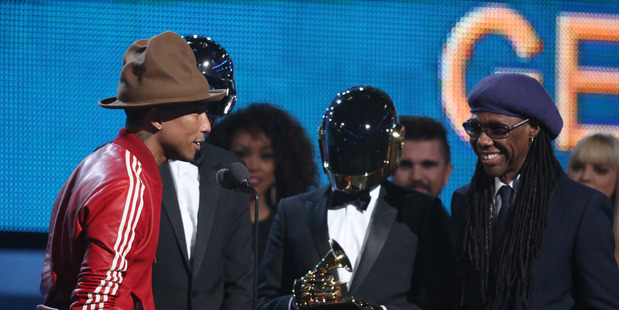 Pharrell Williams, from left, Daft Punk and Nile Rodgers accept the award for best pop duo/group performance at the 56th annual Grammy Awards in Los Angeles.