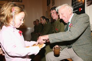 Five-year-old Emily-Jane Stockton, from Christchurch, made sure her granddad, Ben Holloway, had an Anzac biscuit. Photo / File