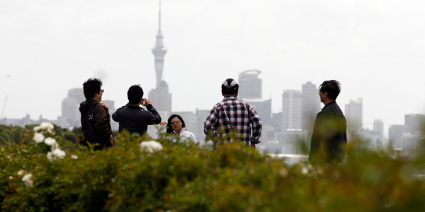 Asian tourists take in the sites of Auckland City from Bastion Point. Photo / Dean Purcell