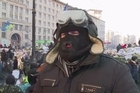 Protesters and Ukrainian police were on Saturday still locked in a tense standoff in Kiev after a night of sporadic clashes that erupted despite a truce and offer of concessions by President Viktor Yanukovych.