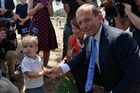 Australian Prime Minister Tony Abbott meets a young Australian at an Australia Day ceremony on Sunday.