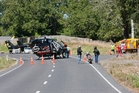 Emergency services (pictured at the scene) are unsure what caused a motorcycle fatality north of Napier on Saturday. Photo/Glenn Taylor