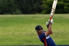 Paras Khadka strikes out to the boundary in his innings against The Netherlands. Photo/Supplied