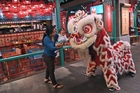 Lion dances, dragon parades, and tasty food stalls are here to usher in the Year of the Horse. Photo / AP