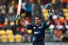 Delighted New Zealand batsman Ross Taylor salutes the dressing room and the fans after scoring his century during the ODI against India in Wellington last night. Photo / Mark Mitchell