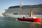 Napier Port tug Ahuriri shadows the largest cruise ship to berth in Napier, Celebrity Solstice. Photo / Warren Buckland