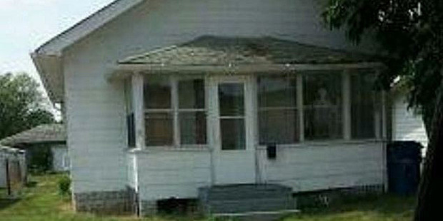 A figure is visible in the window of the Hammond house allegedly haunted by demons. Photo / Hammond Police Department