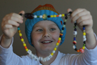 Papamoa 10-year-old Harrison Mundy pictured with his Beads of Courage is one of the children living with cancer who will benefit from the Child Cancer Foundation annual appeal.