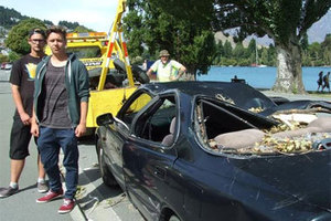 Nico Reiner (left) and Paul Zeller from Germany, say they are out of pocket after a tree in a Queenstown Lakes District Council park fell and crushed their car. Photo / Christina McDonald.