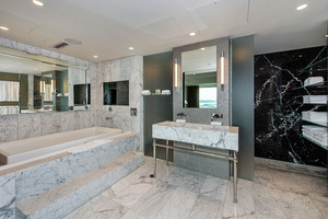 The suite's marble-filled bathroom is home to a Roman infinity bath and seven-nozzle shower. Photo / Supplied