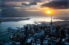 Sun rising over Auckland City. Photo / Brett Phibbs