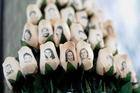 White roses bear the faces of the 26 Sandy Hook victims, including Dylan, the 6-year-old son of Nicole Hockley, right. Photo / AP